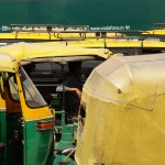 Rickshaws wait for passengers at the New Delhi train station.