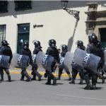 National police patrol the streets of Cajamarca on the fourth of July.