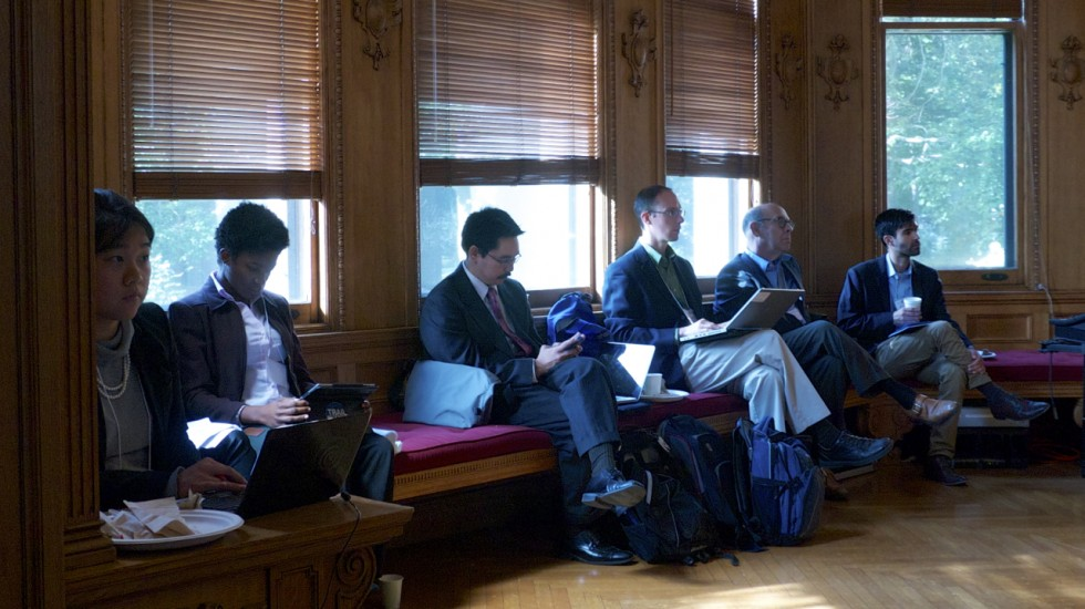 Ambassador Beck sits with students during the 2013 Climate Simulation at Yale University.