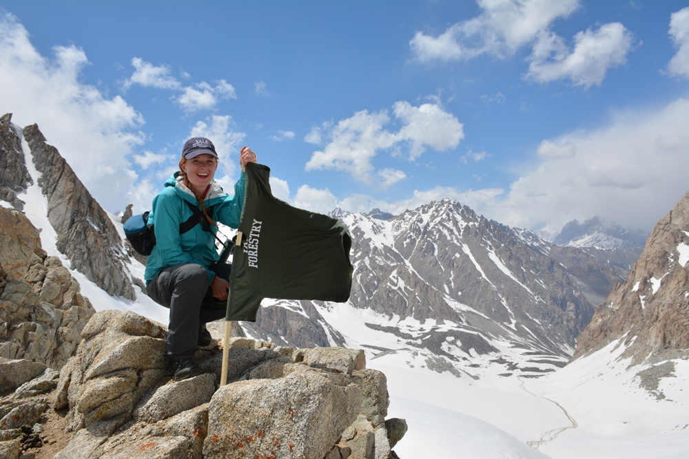The author at the top of Moura Pass shortly before she and her assistant discovered snow leopard scat. Photo courtesy of the author.