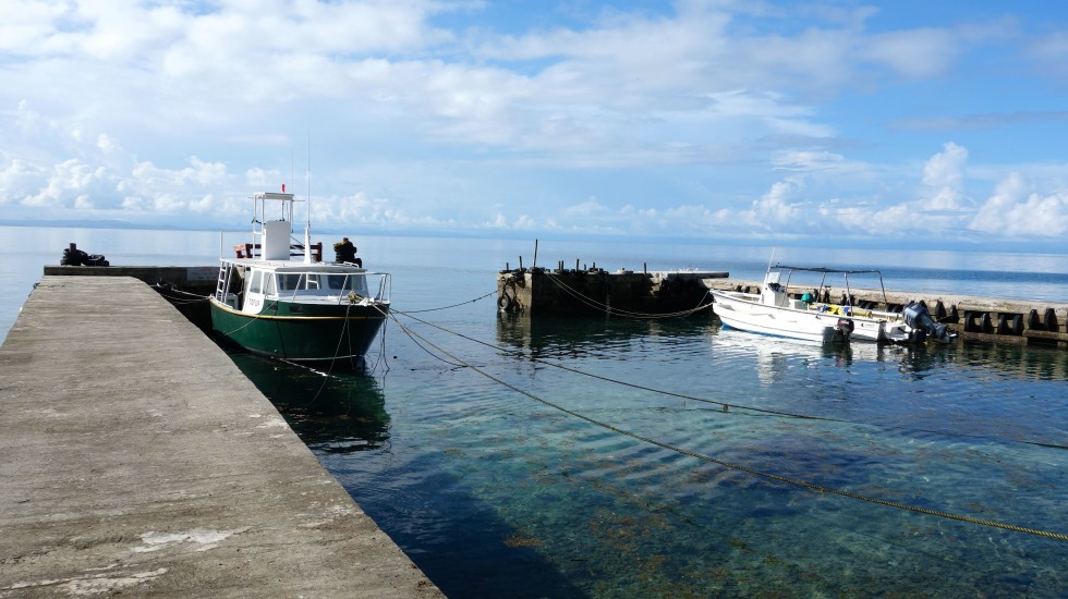 The dive boat awaits at Namenanlala's dock. Photo by the author.