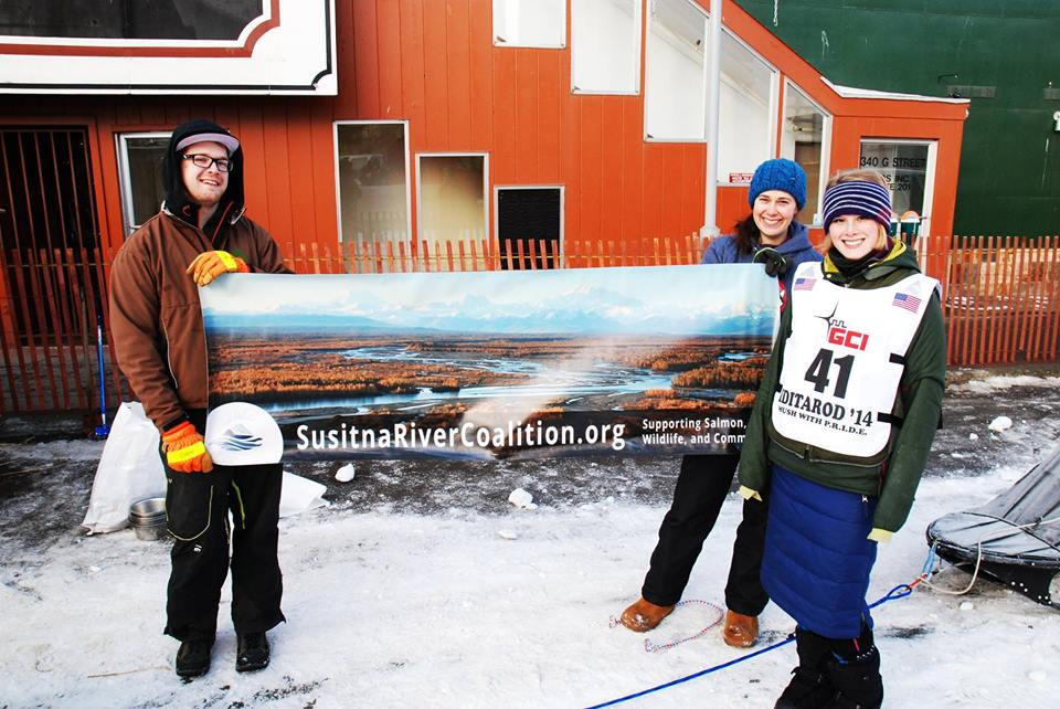 Lisbet Norris shows her support for the Susitna River Coalition at her first Iditarod run in 2014. (Photo credit C. Gibson.)