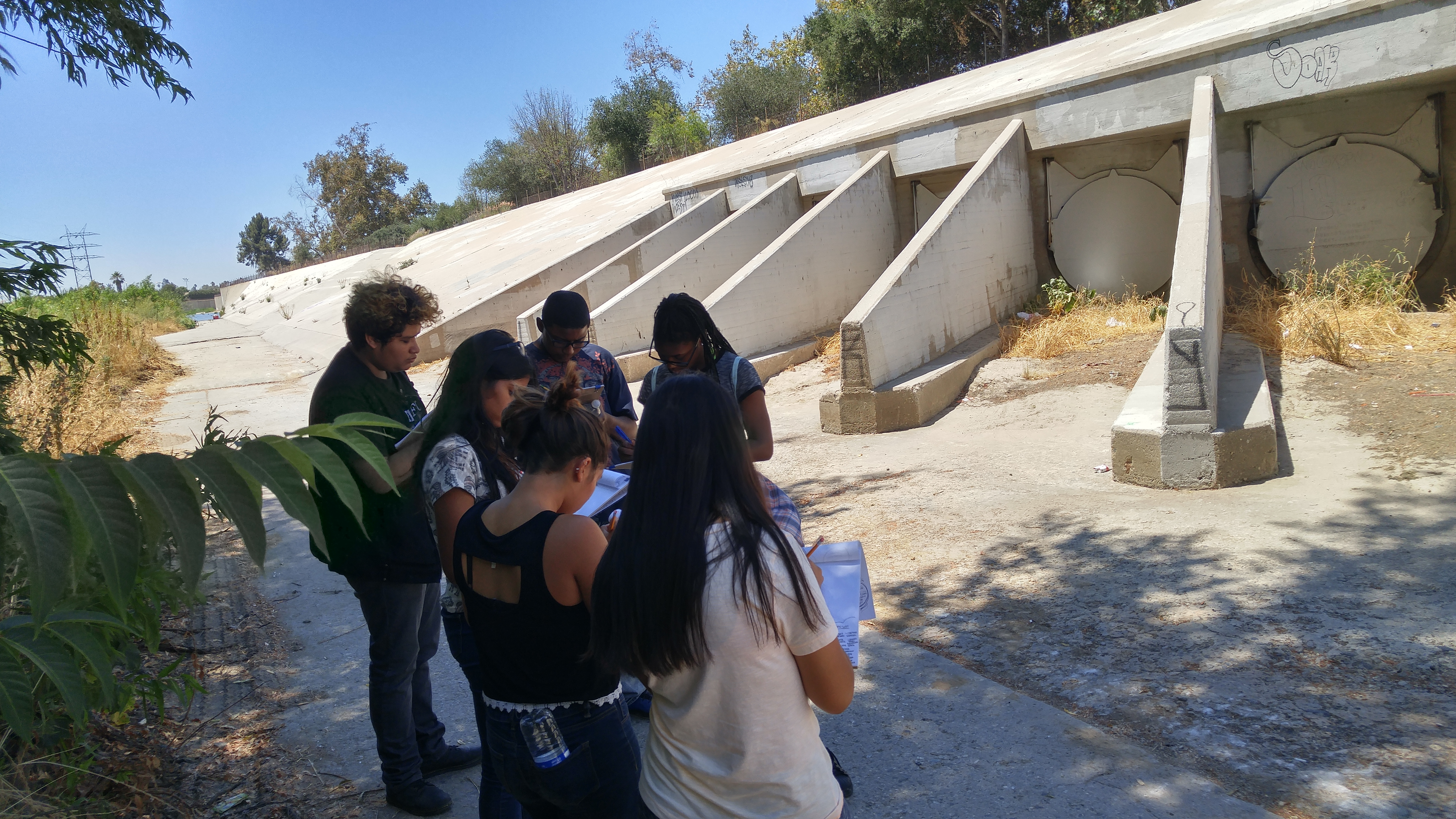 Participants document grey infrastructure along the Los Angeles River. [Photo Credit: Yanin Kramsky]
