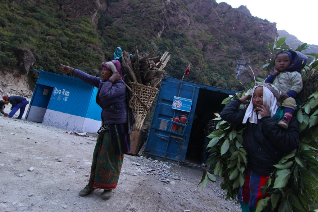 In-Migrant Women Returning From Collecting Fuelwood and Fodder at the Upper Tamakoshi Project Site – Lamabagar, Dolakha District