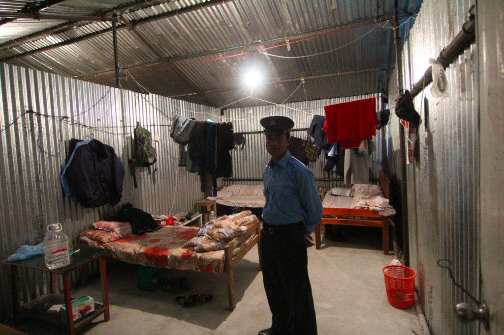 Security Guard in His Quarters within the Upper CGGC Camp at the Trishuli 3A Hydropower Project Site – Salleta, Rasuwa District